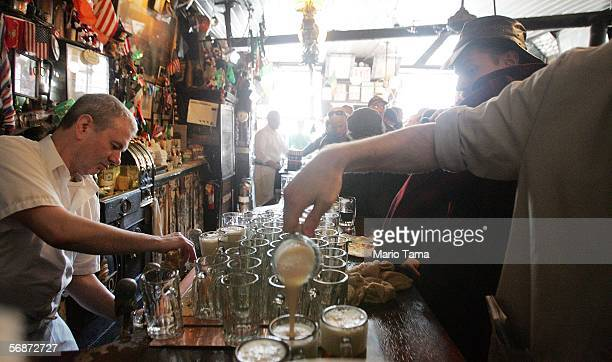 A waiter pours beer in McSorley's Old Ale House as it celebrates its 152nd anniversary February 17 2006 in New York City The legendary bar on East...