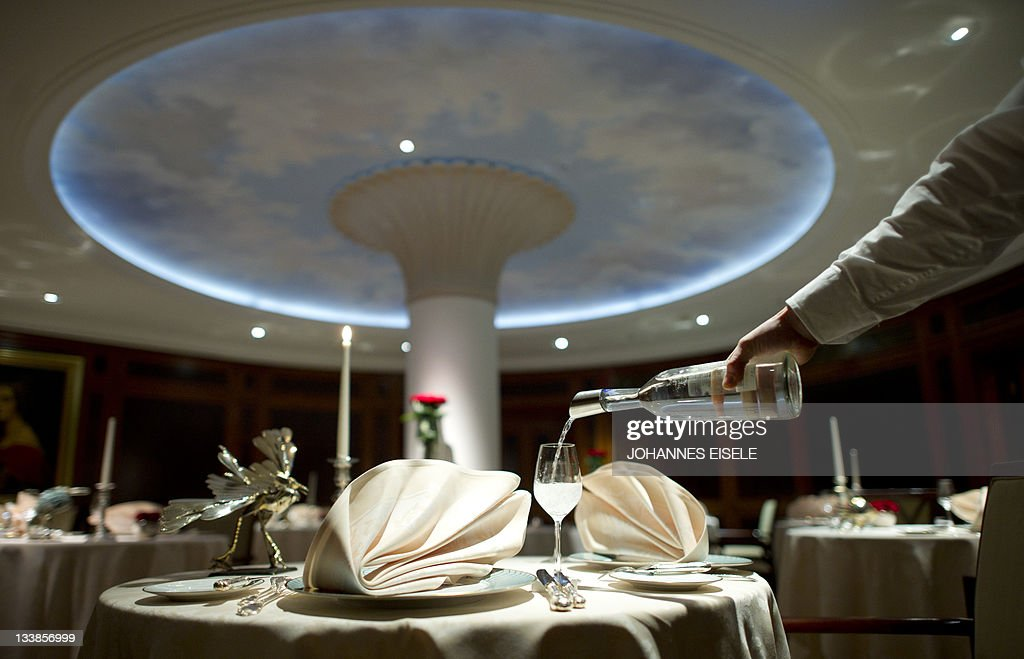 A Waiter Pours Water In A Glass At The Lorenz Adlon Esszimmer Restaurant On  November 17