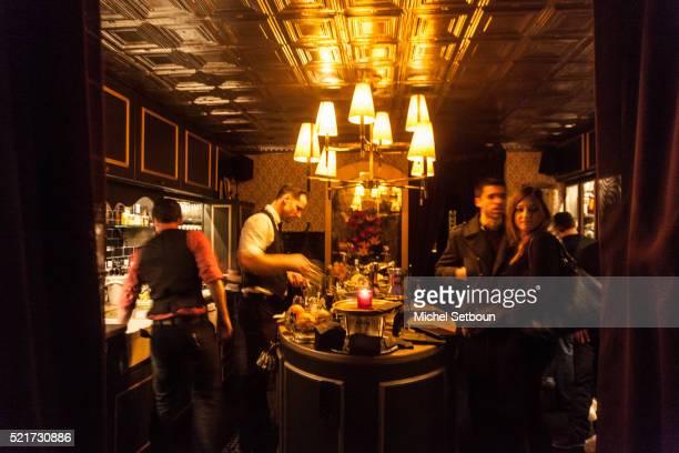 Waiter prepare cocktail in a speakeasy bar