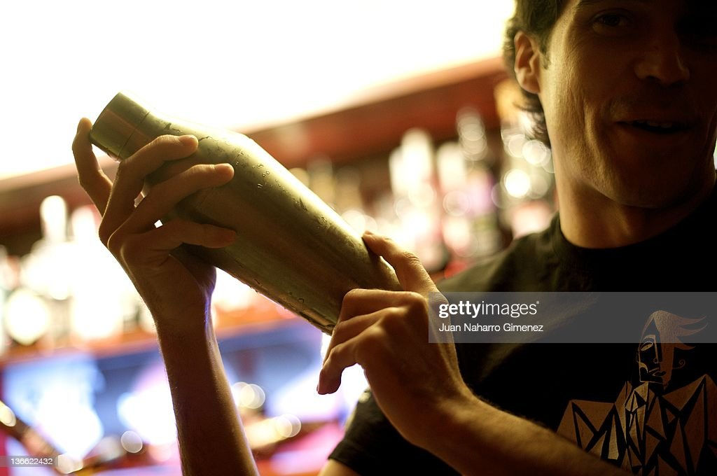 A waiter prepares a cocktail at 'Museo Chicote' on January 6, 2012 in Madrid, Spain. Opened by Perico Chicote in 1931, the 'Museo Chicote' is one of the first local of cocktail in Madrid and had a collection of more than 18,000 bottles of liquor. Visited by a multitude of celebrities such as Ava Gardner, Joan Crawford, Liz Taylor, Auntie Hayworth, Sofia Loren, Gina Lollobrigida, Bete Davis, Errol Flynn, Vittorio de Sica, Gary Cooper, Orson Welles, James Stewart Nowadays is the favourite place os many Spanish actors and directors to celebrate cinema awards.