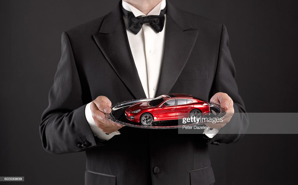 Waiter presenting auctioned car