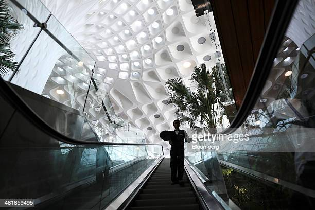 A waiter rides on an escalator inside the newly built Terminal 2 of the Chhatrapati Shivaji International Airport operated by GVK Power...