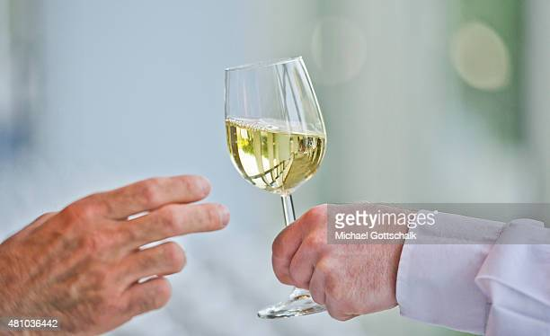 A waiter serves a glass of Riesling white wine on July 05 2015 in Mainz Germany