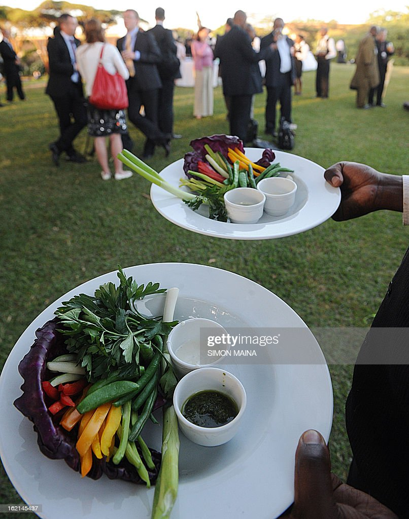 A waiter serves rejected green salad, grown by Kenyan farmers but rejected by UK supermarkets due to cosmetic imperfections, on February 19, 2013 during the Governing Council of the United Nations Environment Programme (UNEP) at the UN headquarters in Nairobi. The campaign aims to promote actions by consumers and food retailers to dramatically cut the 1.3 billion tonnes of food lost or wasted each year -- which, aside from the cost implications and environmental impacts, increases pressure on the already straining global food system -- and help shape a sustainable future.