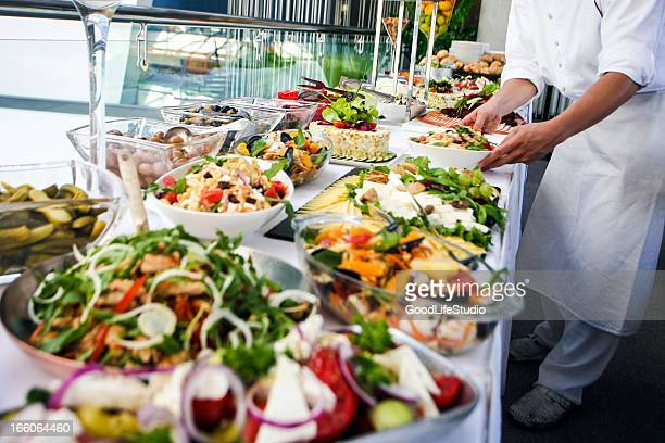 Waiter serving a buffet table