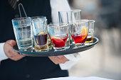 Waiter serving alcohol