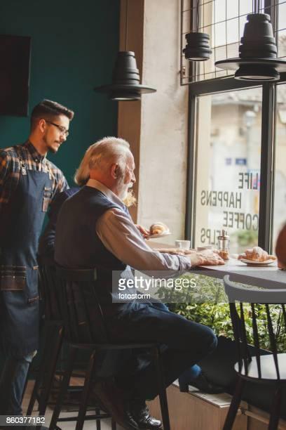 Waiter serving breakfast