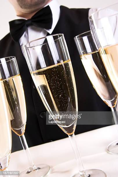 Waiter serving champagne on a tray