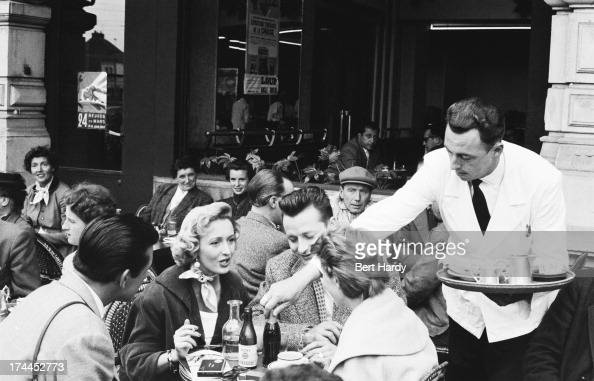 A waiter serving clients outside a cafe in Le Mans France July 1955 Original publication Picture Post 7852 MotorRacing Must Go On pub 12th July 1955