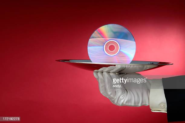 Waiter Serving Compact Disc on a Silver Platter