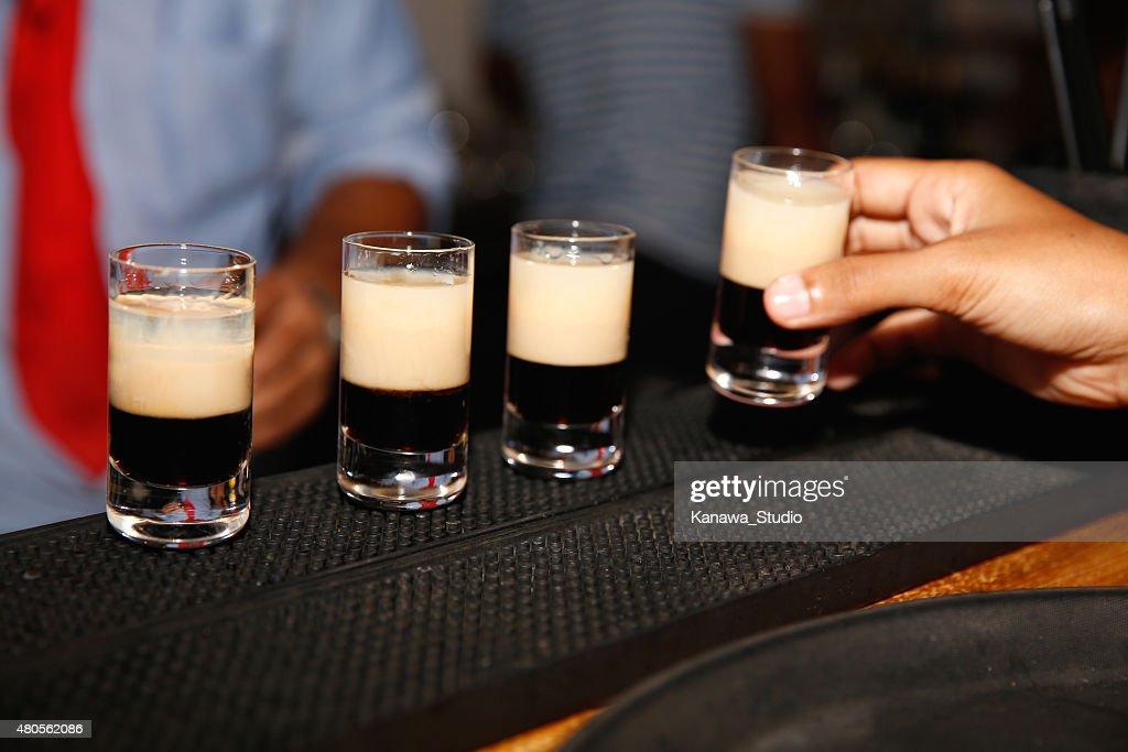 Waiter serving shots on bar : Stock Photo