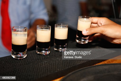 Waiter serving shots on bar : Stock Photo