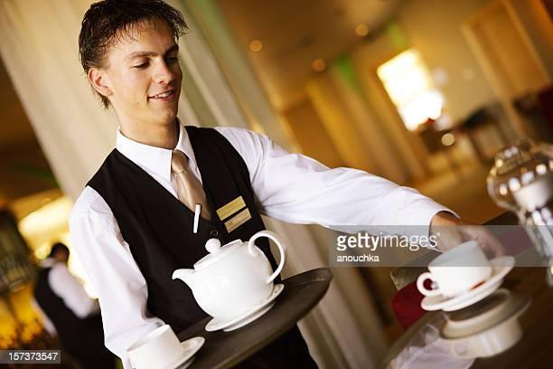 Waiter serving Tea