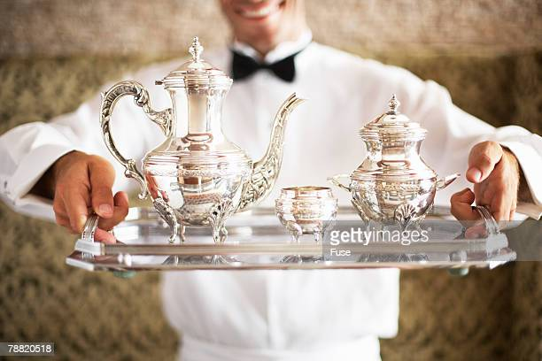 Waiter Serving Tea