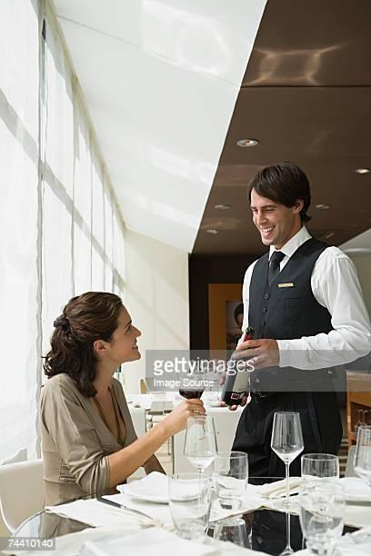 Waiter serving woman