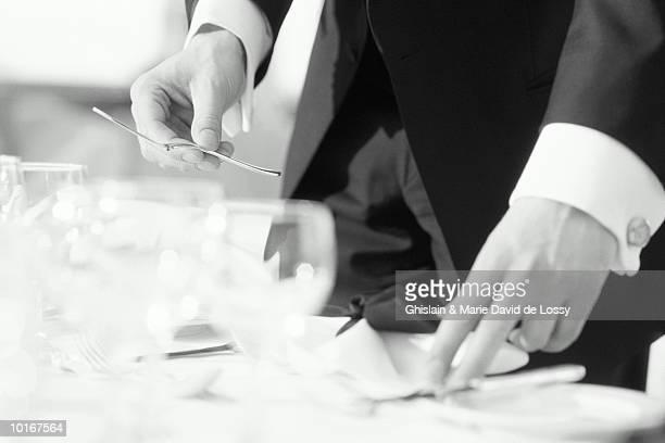 Waiter setting table, detail (B&W)