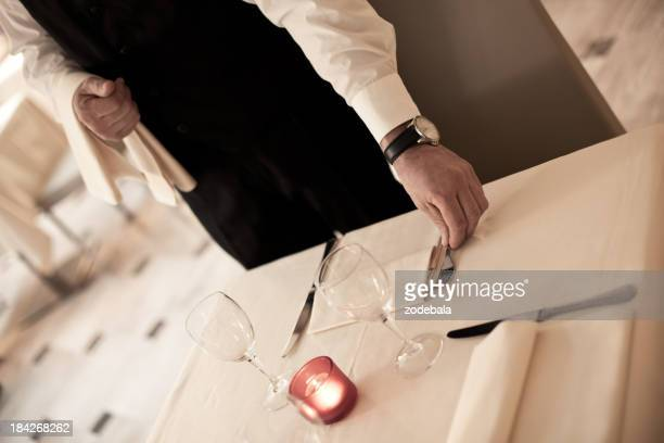 Waiter Setting the Table for Elegant Dinner