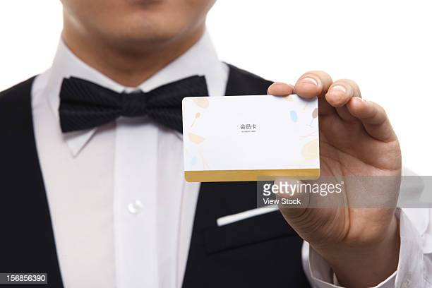 Waiter showing VIP card