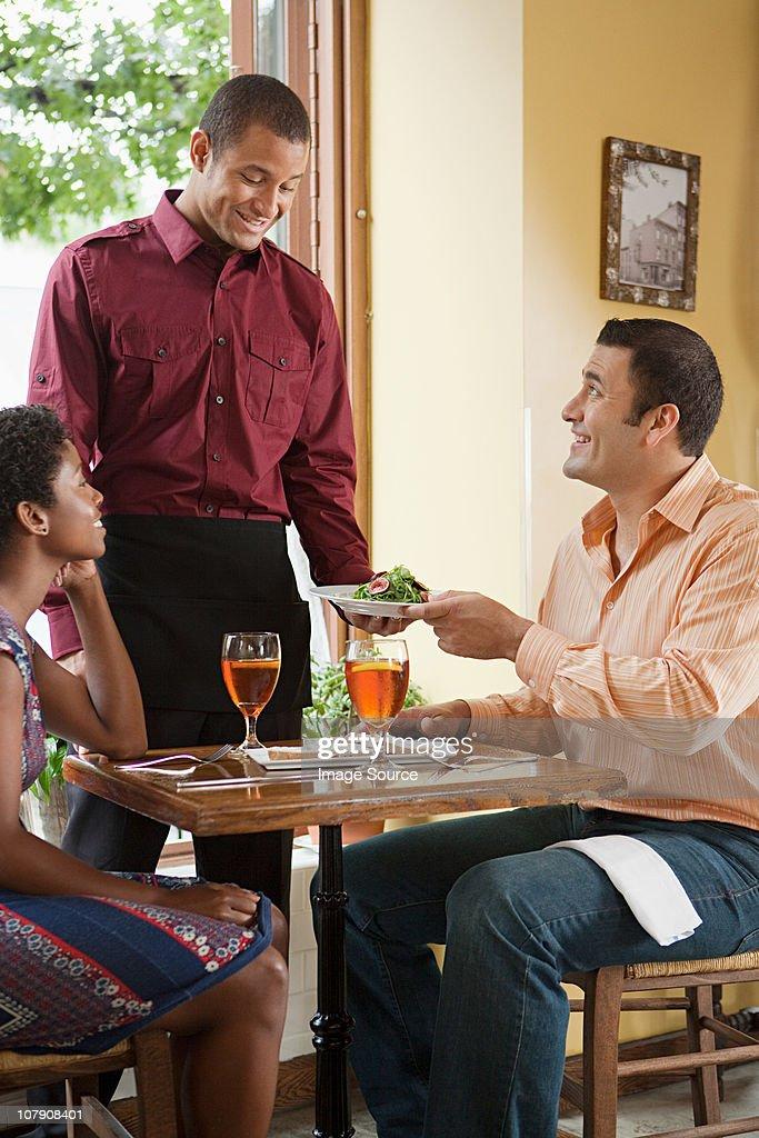Waiter taking customer orders in restaurant : Stock Photo