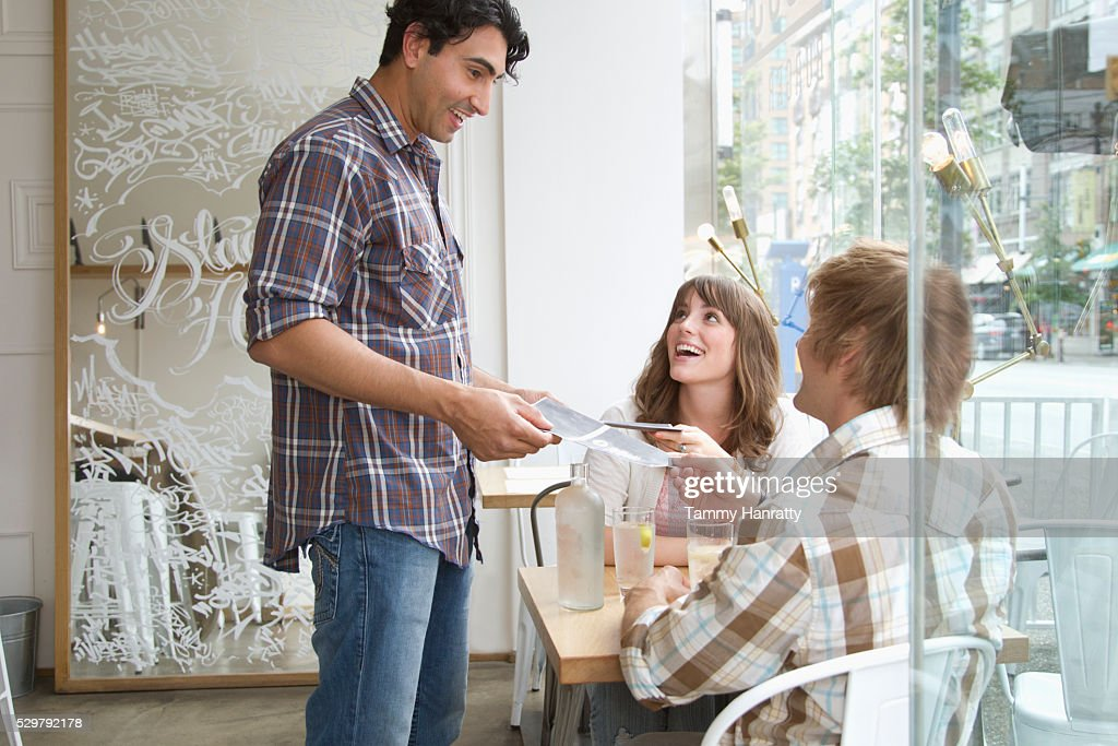 Waiter taking order in restaurant : Foto de stock