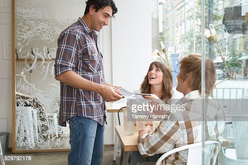 Waiter taking order in restaurant : Stock Photo