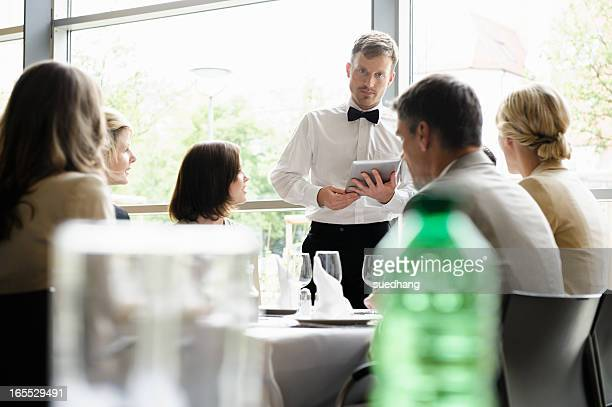 Waiter taking order with tablet computer