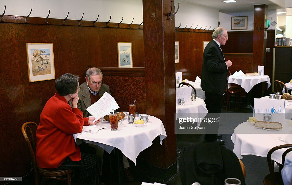 A waiter waits for customers at Sam's Grill December 3, 2008 in San Francisco, California. A report by The Institute for Supply Management says that its services sector index dropped in November to 37.3, down from 44.4 in October as the service industry struggles through the weak economy.
