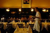Waiter walking through restaurant, blurred motion