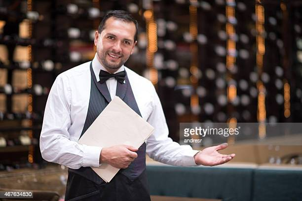 Waiter welcoming people to a restaurant