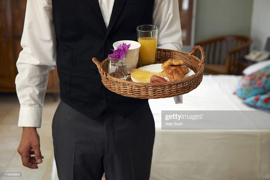 Waiter with breakfast tray : Stock Photo
