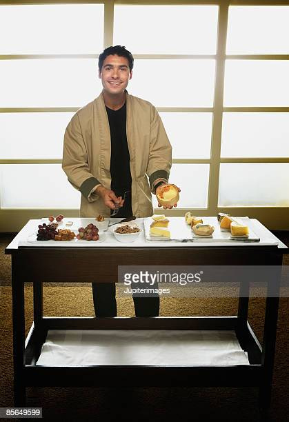 Waiter with cheese assortment