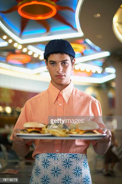 Waiter with Tray of Food