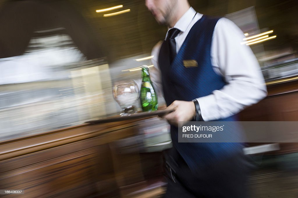 A waiter works in a French brasserie 'Le Train Bleu', on April 11, 2013 in Paris.