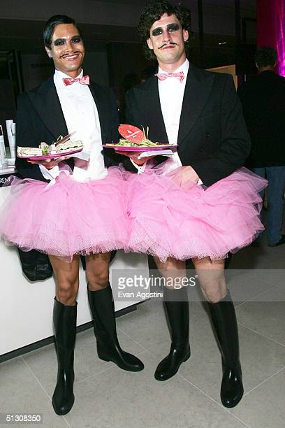 Waiters are seen at the Holt Renfrew party during the 2004 Toronto International Film Festival on September 14 2004 in Toronto Canada