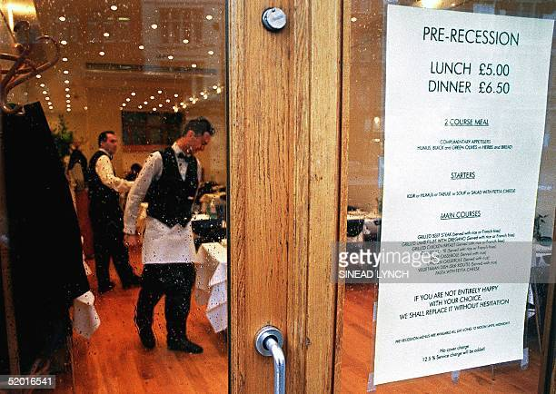 Waiters at a West London restaurant serve tables as a sign advertises their discount 'Prerecession' lunch menu 12 January The latest surveys have...