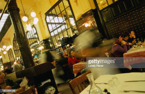 Waiters in motion in Chartier.
