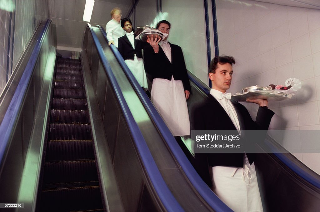 Waiters leaving the kitchen on a conveyor belt. The Dorchester Hotel on London's Park Lane opened its doors on April 18th 1931. Since then the name has become synonymous with luxury, style and glamour. Hollywood actors have particuarly enjoyed its special glitzy comfort, Richard Burton, Elizabeth Taylor, James Mason, Yul Bryner, Julie Andrews, Warren Beatty, Peter Sellers, Tom Cruise and Arnold Schwarzenegger have all fallen in love with the hotel's unique atmosphere.