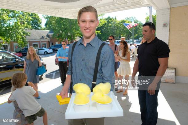 Waiters pass food and drinks during a screening of Despicable Me 3 hosted by Gwyneth Paltrow and goop at Southampton Movie Theatre on July 5 2017 in...
