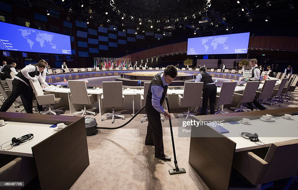 Waiters prepare the plenary table during a break at the 2014 Nuclear Security Summit on March 25, 2014 in The Hague, Netherlands. Leaders from around the world have come to discuss matters related to international nuclear security, though the summit is overshadowed by recent events in Ukraine.