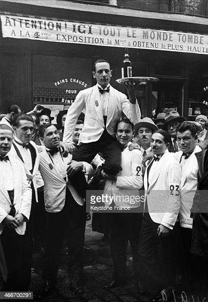 Waiter's race in Montmartre from Place de Clichy to Barbes Rochechouart holding a tray with a bottle and three glasses Here the winner Joseph Simon...