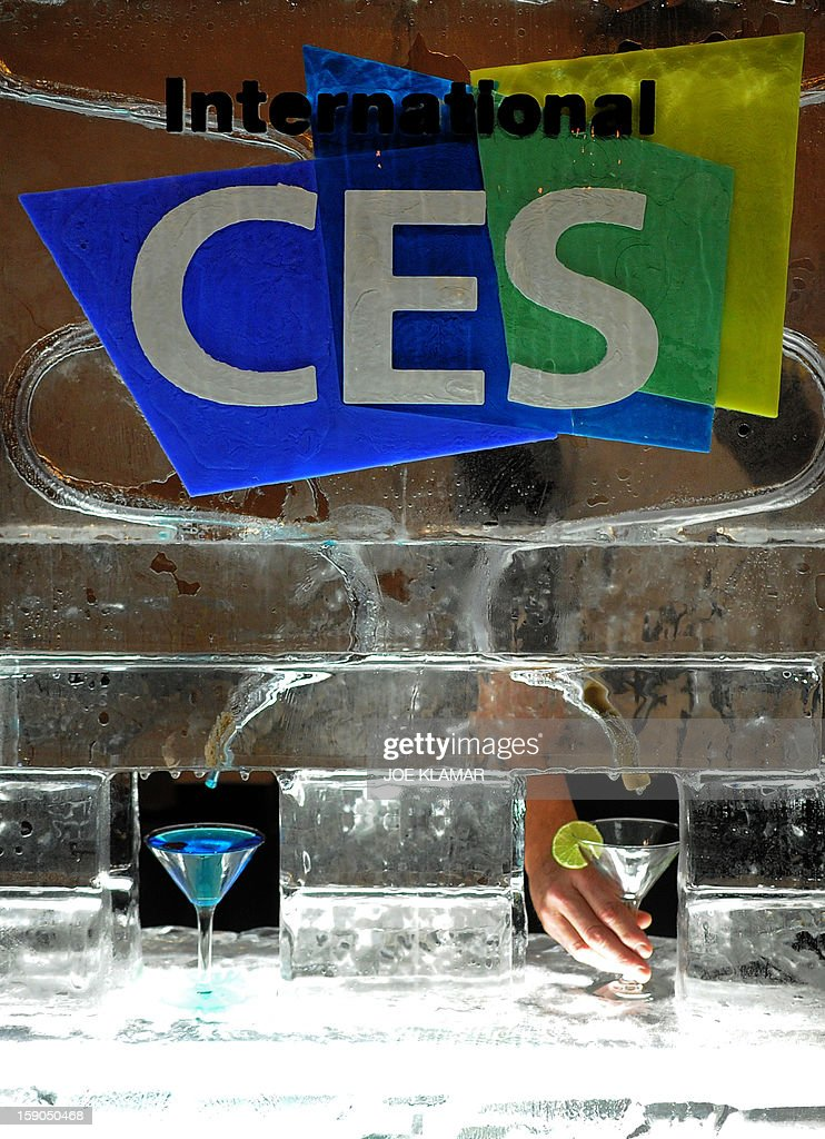 Waiters serve ice-cold Martini during the opening event ''CES Unveiled'' during the International Consumer Electronics Show (CES) in Mandalay Bay Hotel resort on January 06, 2013 in Las Vegas, Nevada.