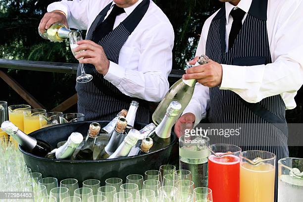 waiters serving champagne