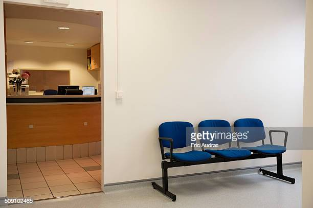 Waiting bench outside of doctor's office in hospital