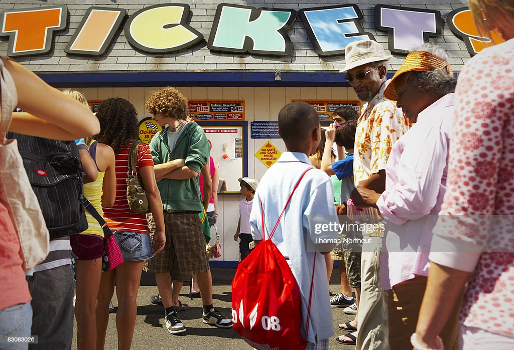 waiting in ticket line at amusement park : Stock Photo