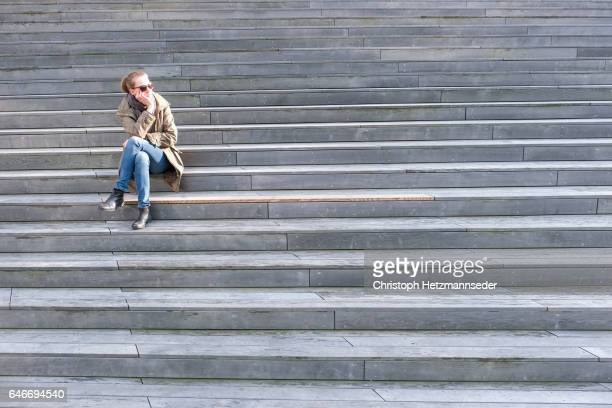 Waiting on stairs
