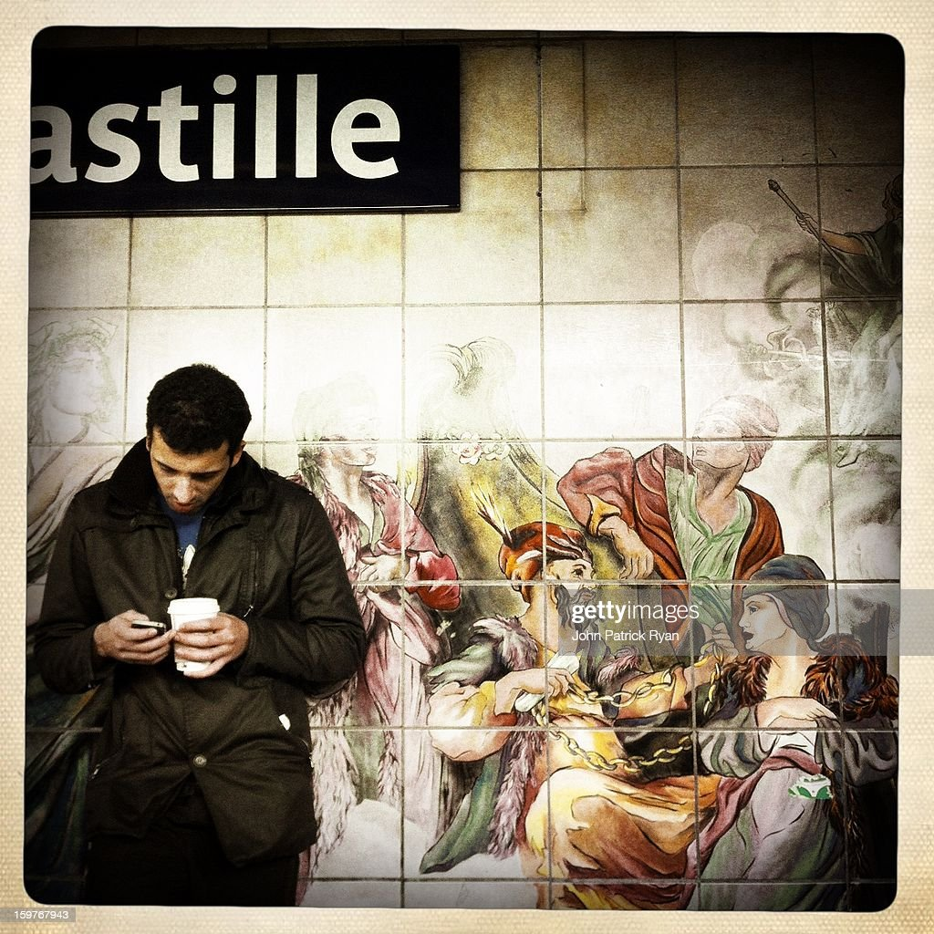 CONTENT] Waiting on the world to change. Or at least the song. A man waits for a metro at the Bastille stop in Paris, France.