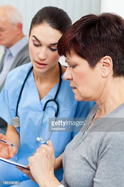 Waiting room - Nurse and patient examining application form