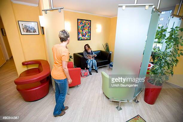 Waiting room of a dentist's office with patients and female medical assistent on May 14 2014 in Cologne Germany
