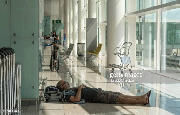 A waiting traveler rests before departure at Terminal 1 of Barcelona El Prat Airport on September 10 2017 in Barcelona Spain Barcelona El Prat...