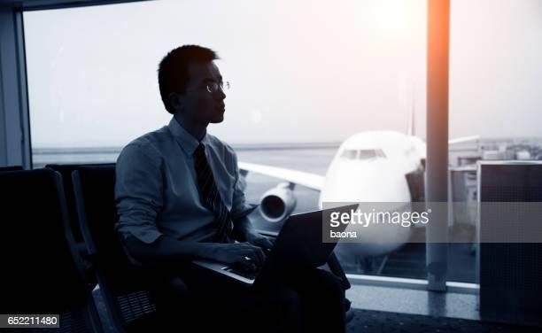 waiting traveller using laptop